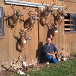 NextBuk Outdoors Pro Staffer Gary Sparks from Ohio with wall of big bucks