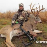 Pro staffer Justin Hollandsworth with big 8pt whitetail archery kill buck