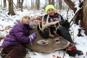 jordyn and jacob erdody with their dad's buck